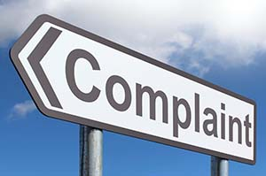 "a sign reading ""complaint"""