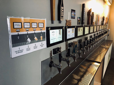 pour-it-yourself taps from a bar in San Francisco